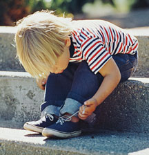 5 tips and tricks for teaching your child how to tie their shoes