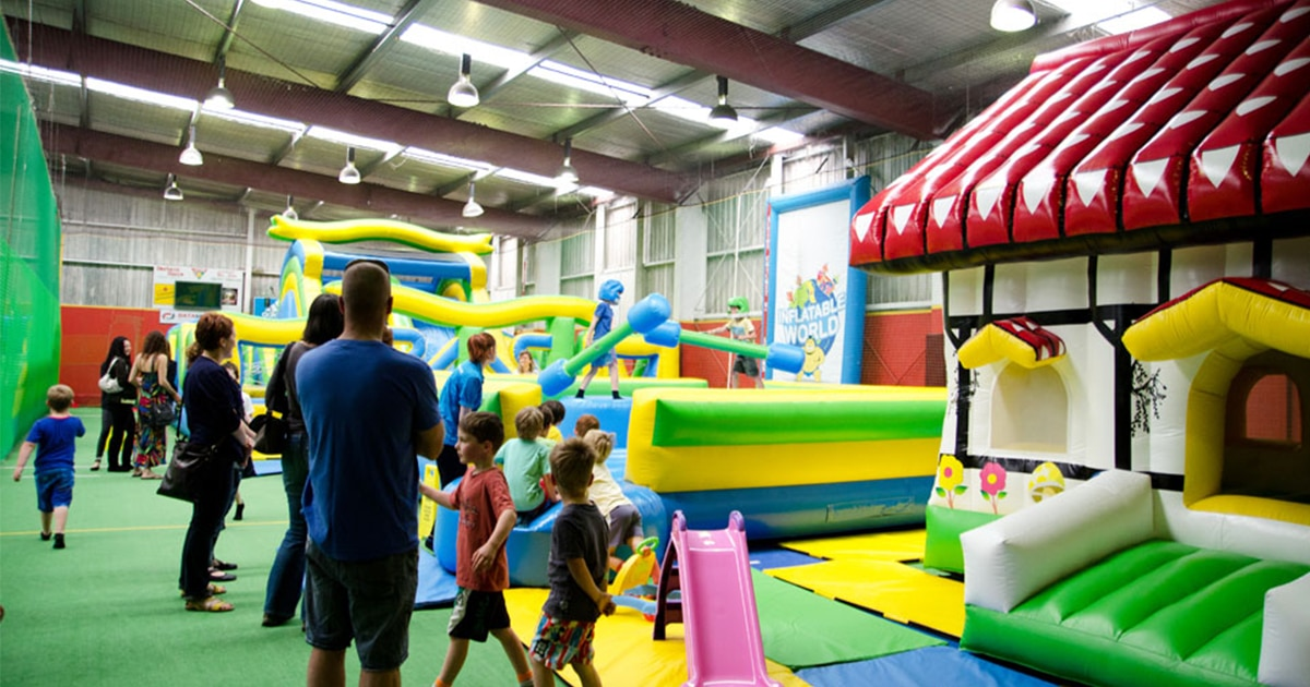 a room full of inflatable toys and climbing activities