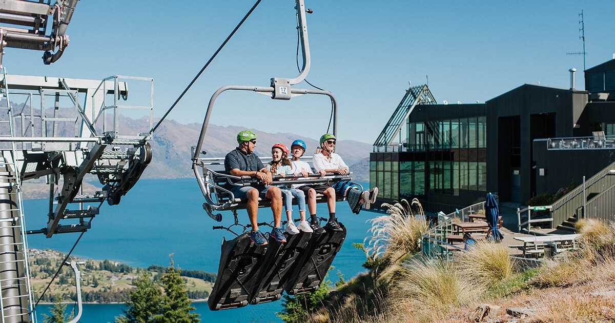 A family going up the luge skyline in Queenstown